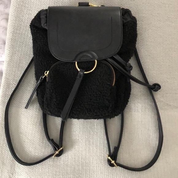 354e57d4795b Black faux fur mini backpack. M 5c4499d7819e90c73f81cb57